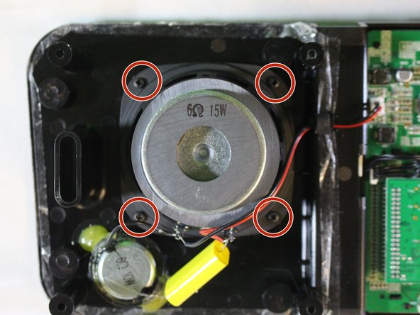 Remove (4) screws (14 mm) with a PH1 screwdriver around the speaker.