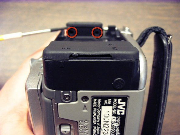 Remove 2 screws on the underside of camera eyepiece.