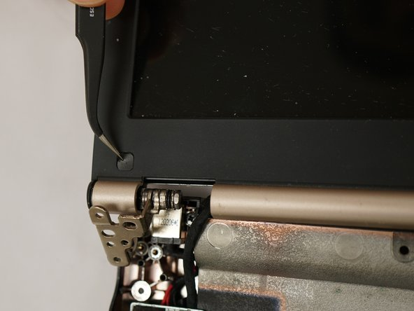 Use tweezers to remove both plastic screw cover.