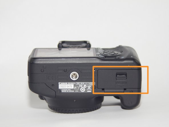 Open the battery compartment on the bottom of the camera and remove the battery. Then close the battery compartment.