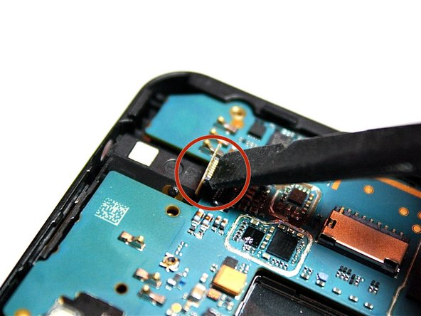 Image 2/3: Open the gold-plated cable on the upper right-hand corner of the motherboard.