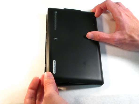 With your fingers, carefully pry off the back plastic casing. Starting at the corners is usually the easiest.