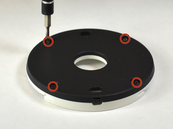 Image 2/2: Remove the four 6 mm screws from the back of the base using a #0 Phillips screwdriver.