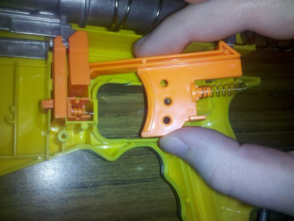 Image 2/3: With the cocking mechanism forward, you should be able to reinstall the trigger (if you removed it earlier).