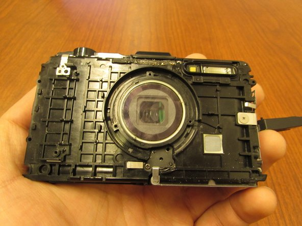 Image 3/3: Once every screw and panel is removed you can now replace your backplate to make your camera weatherproof once again.
