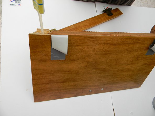 Run a thick bead of epoxy on the inside rim of the cabinet from one end to the other.