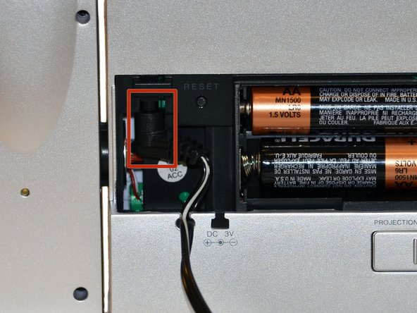 Image 2/3: Once battery cover is removed, pull down on AC Adapter Jack.
