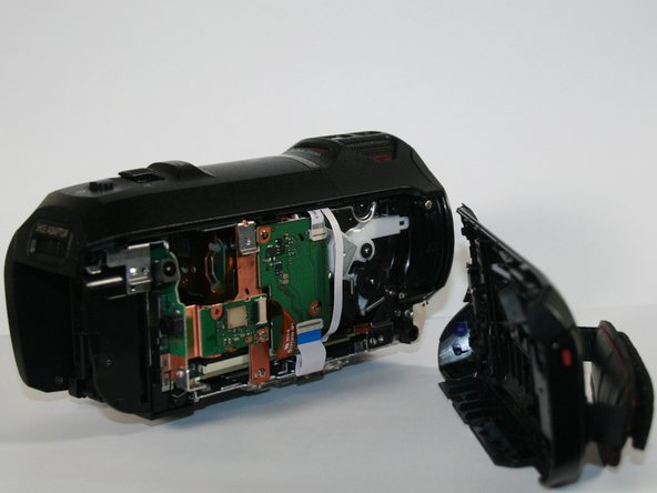 Pull off the left side of the camcorder. You may have to use a little force but don't worry about breaking anything in the camcorder.