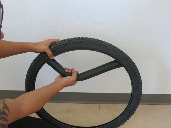 Pull the inner tube away and out of the tire until it is completely detached from the tire.