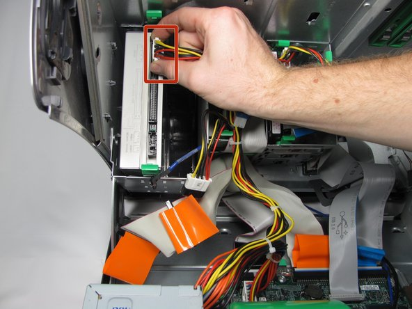 Remove the IDE cable form the optical drive by pulling straight up on the orange plastic tab..