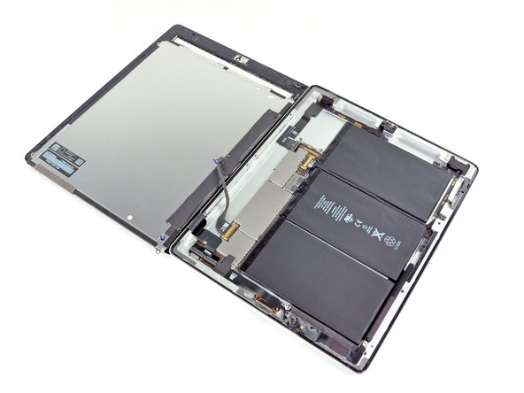 Be very careful when moving the LCD, and do not attempt to remove it from the iPad—its display data cable will remain connected while it is rotated over.