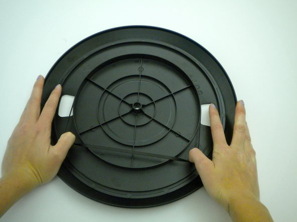 Install new belt by securing it around the inner ring, located on the back of the platter.