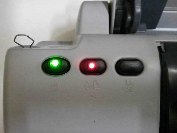 When you are low on ink your green power light will be flashing and your error light will stay a solid red.