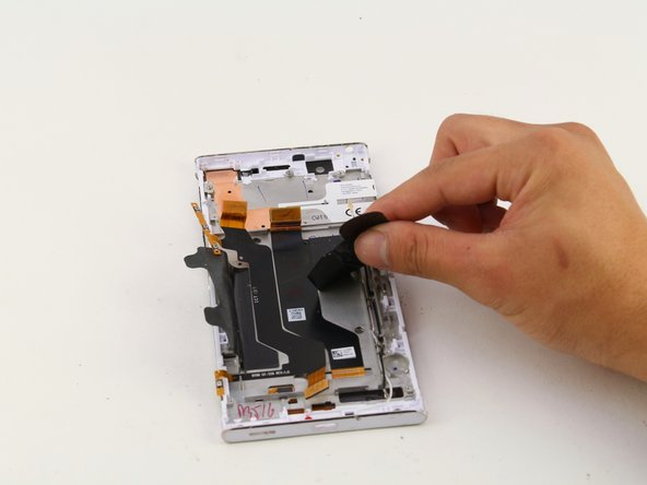 Grab the two pieces of black tape holding down the battery with your hands.