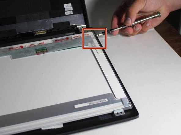 Remove the four screws that mount the panel onto the mounting arms. There should be a screw on every corner. You will need your screwdriver for this.