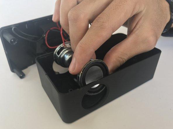 Slide the speaker upwards to detach them.