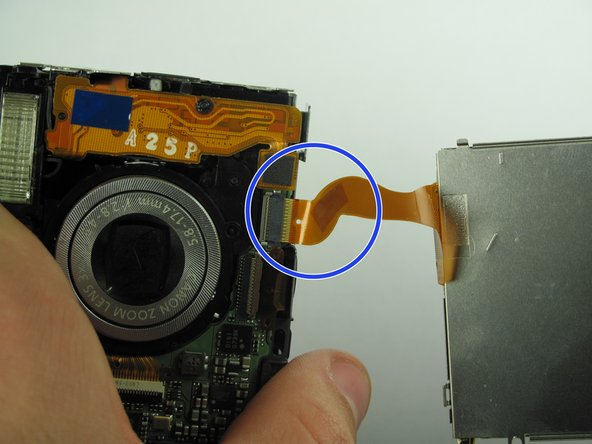 Image 2/2: Remove the side orange ribbon by gripping the connector on the camera and sliding it straight out.