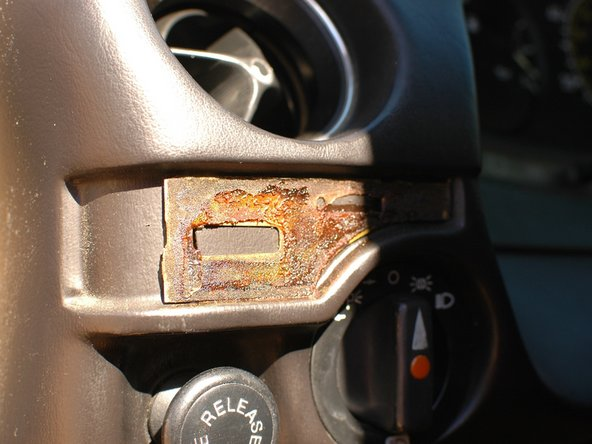 "The metal backing plate behind the wood trim strip is held to the dash by a few ""pegs"" and can only be safely removed from behind. To make this easier, you can simply leave the metal strip on the dash."
