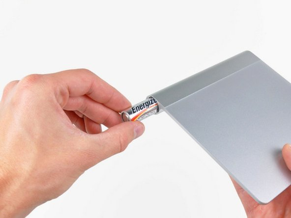 Remove the batteries to prevent any short-circuiting while fixing your Magic Trackpad.
