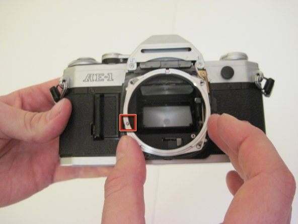 After the screws have been removed, pull the SLR Lens Mount away from the body of the camera