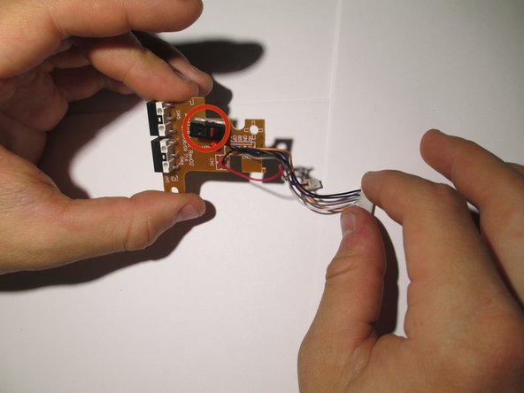 Image 1/2: To remove it, flip the board over and desolder the wires highlighted in orange.