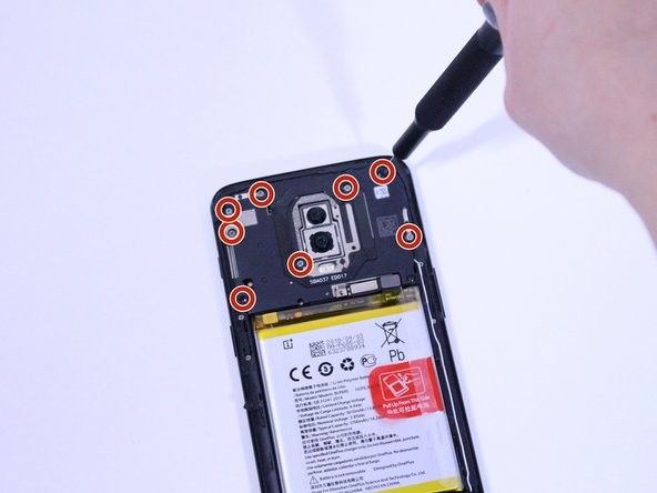 Remove eight 3mm Phillips #00 screws that connect the midframe to the phone.