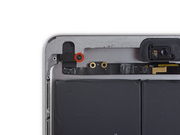 Remove the single 4.4 mm Phillips #00 screw securing the headphone jack to the rear case.