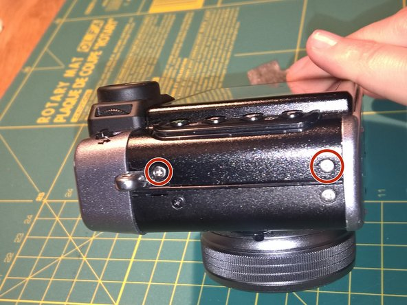 Remove two screws from the left side of the camera