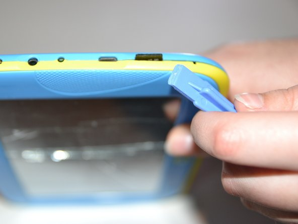 Use the plastic opening tool help push out the microSD card from the microSD slot.