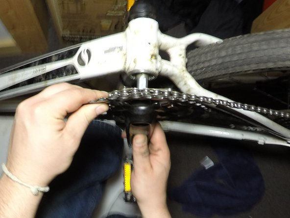 Remove the crank arm and chainrings by pulling the crank arm away from the bicycle frame.