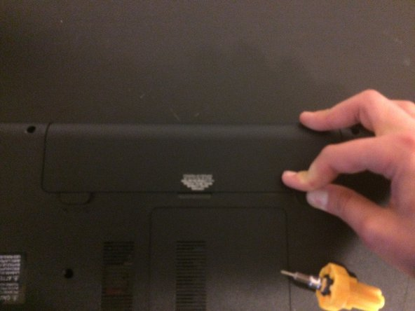 Then hold the right switch to the right and push the battery in, then release the switch.