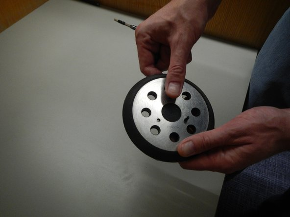 When the screws are removed, the disc pad will come off of the sander.