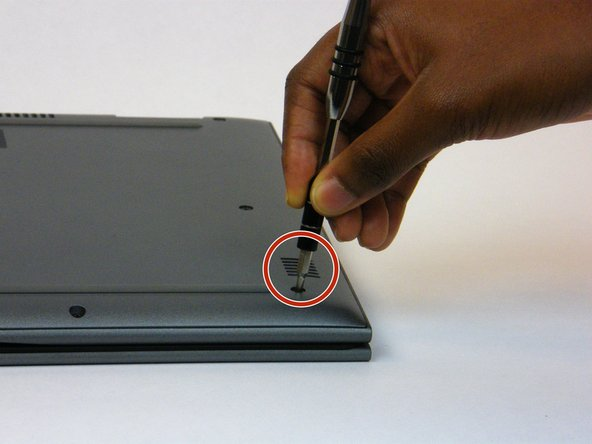 Remove the nine 6mm Phillips #0 screws that secure the back cover of the laptop.