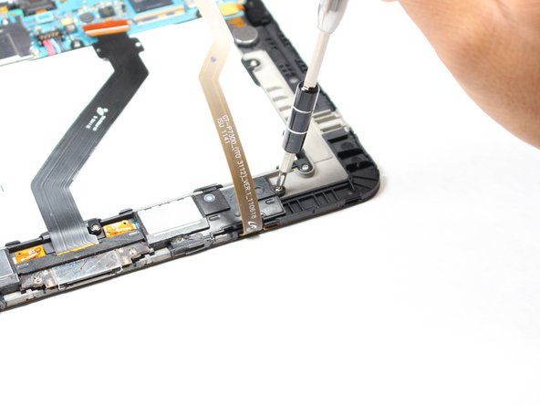 Using a Phillips #00 screwdriver, unscrew the 4 screws (3mm) that are holding the charger port and speaker support.