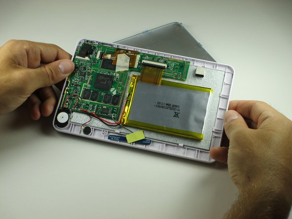 Image 1/2: Gently remove the back cover. There are wires inside that may get caught on the cover while removing it. These wires are soldered to their components and are difficult to reattach.