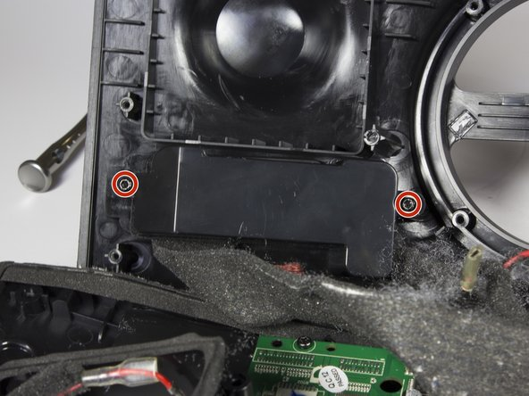 Use a TR 10 driver to remove the two 10mm screws securing the connector housing.