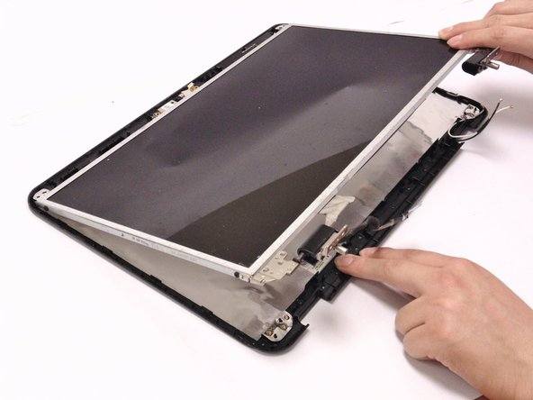 Lift and remove the LCD screen from the backing.