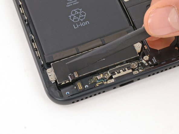 Pry up the Taptic Engine's ribbon cable connector to disconnect it.