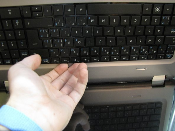 After removing the screws securing the keyboard, you will need to flip the keyboard release switch to the left (in previous step). You should feel the release slightly make the switch less springy