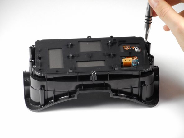 Image 2/3: Gently lift the plastic screen holder and display screen away from the remaining piece of the faceplate.