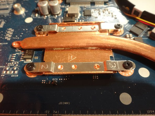 Remove the four screws that are attaching the heat sink (copper) to the motherboard. Use a phillips head PH0 screwdriver to do this.