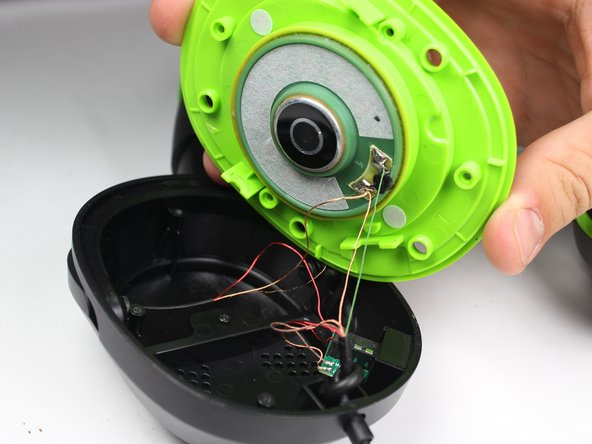 Be gentle; the small wires connecting the speaker cone to the rest of the device may break if you pull too hard.