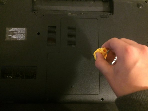 Image 2/2: Then screw in the screw next to the information sticker