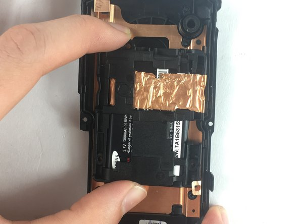 Remove the battery brace and battery from the camera casing.
