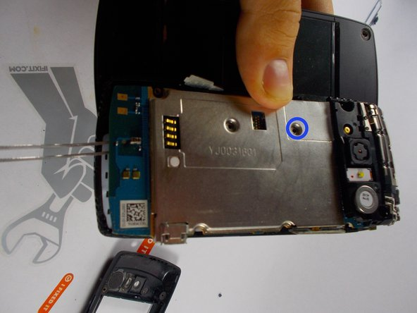Remove the phillip screw from the small white box on the top left corner that's on the battery platform of the phone.