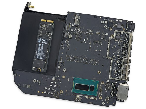 And on the top of the tray, a promising mounting point for a blade-style PCIe SSD, presumably what we'll find in a Mac mini equipped with Fusion Drive.