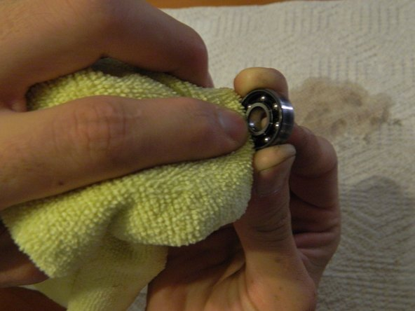 Carefully blot your bearing with a lint-free cloth to remove any excess cleaning solution.