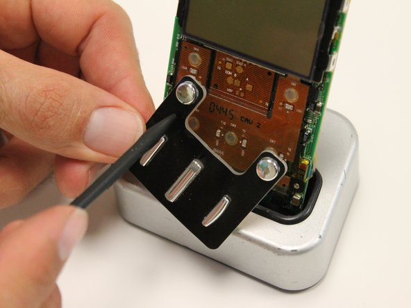 Inspect and clean device buttons with appropriate materials.