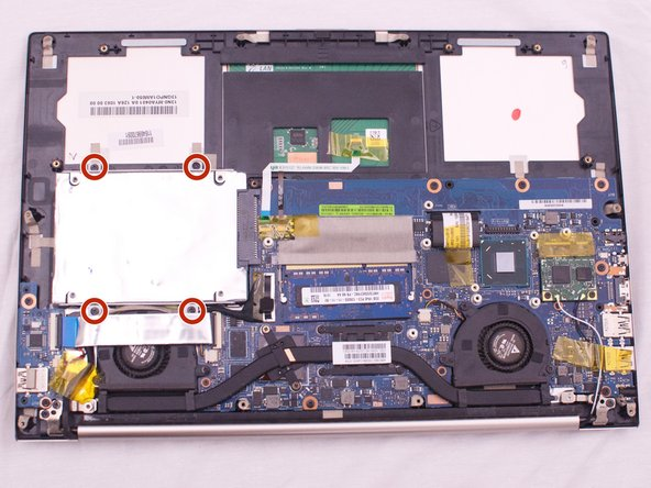 Remove the four 3mm hard drive screws with a Phillips #0 Screwdriver.