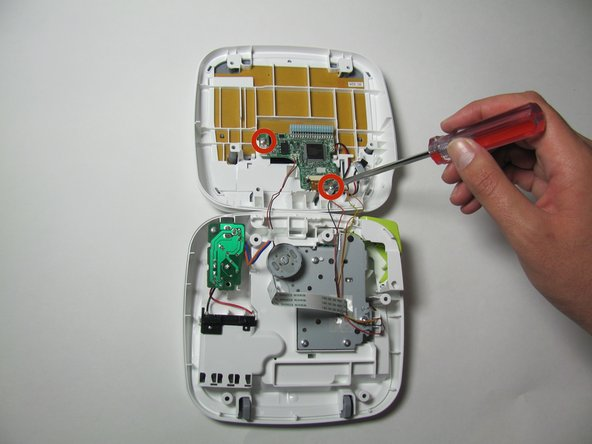 "Remove the two 3/16"" screws from the circuit board using the Helping Hand 1/4"" screwdriver."